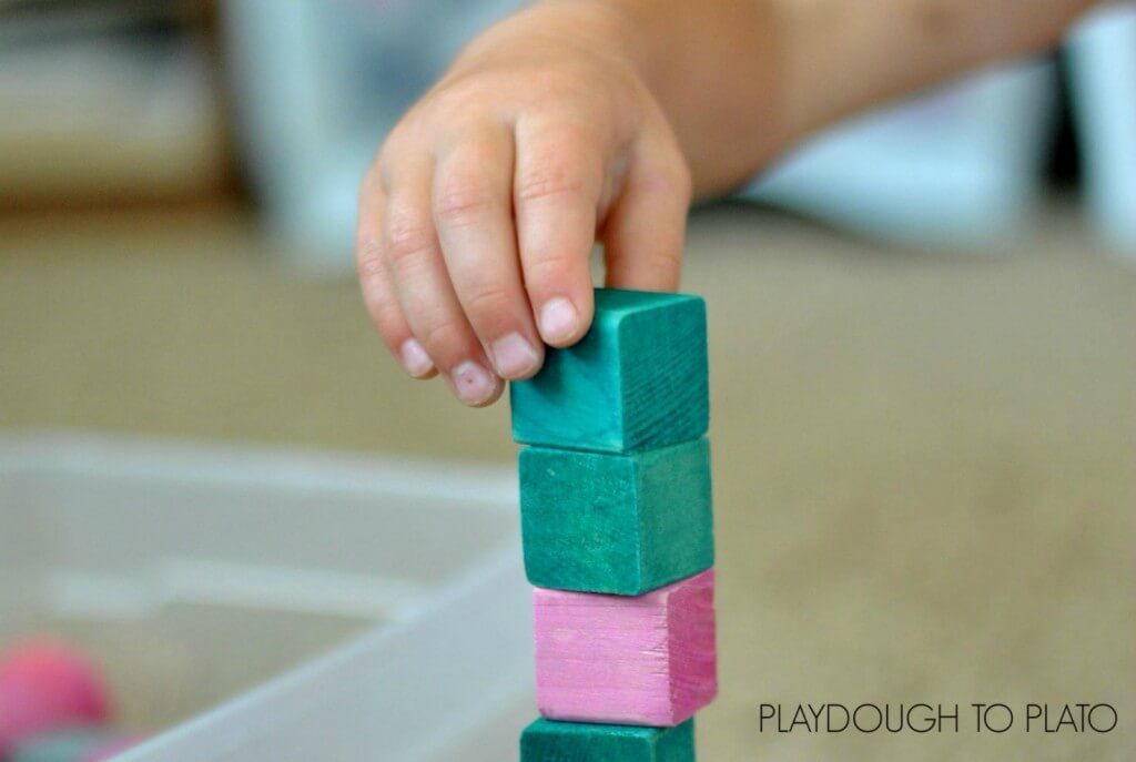 the stages of block play and why it is important for fine motor development - Playdough to Plato.2