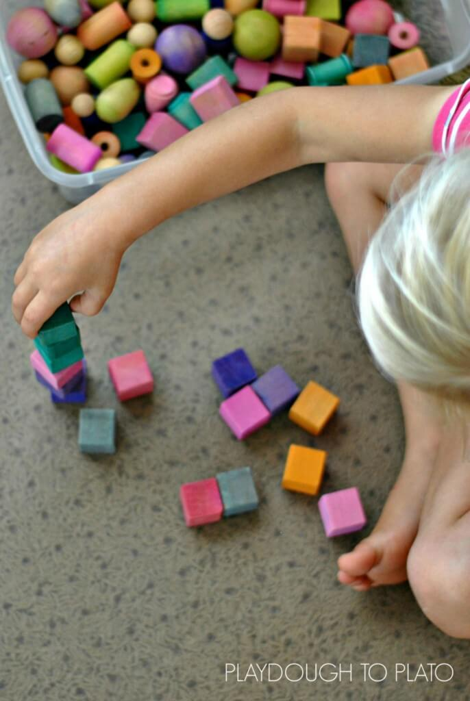 the stages of block play and why it is important for fine motor development - Playdough to Plato.3